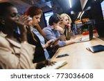 coworkers bonding in pub | Shutterstock . vector #773036608
