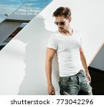 young handsome model posing | Shutterstock . vector #773042296