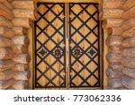 wooden doors with iron forging. ... | Shutterstock . vector #773062336