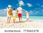 back view of a happy family... | Shutterstock . vector #773062378