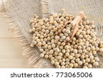 soybean in wood spoon on sack... | Shutterstock . vector #773065006