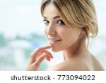 beautiful  smiling girl with... | Shutterstock . vector #773094022