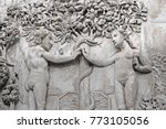 Small photo of The Fall of Man (Eden narrative) - Adam and Eve take fruits from a Tree of life in Garden of Eden - relief on an external facade of Cathedral Orvieto (Duomo), Umbria, Italy