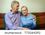the old man hugs his wife.... | Shutterstock . vector #773264392