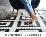 woman sitting in armchair with... | Shutterstock . vector #773355895