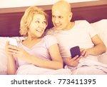 positive mature couple reading...   Shutterstock . vector #773411395