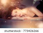 a sleeping girl under a... | Shutterstock . vector #773426266