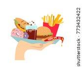 hand with junk food. hand... | Shutterstock . vector #773432422