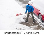man clearing snow in his... | Shutterstock . vector #773464696