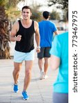 two friends are doing race in... | Shutterstock . vector #773467975