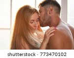 sensual couple with eyes closed.... | Shutterstock . vector #773470102