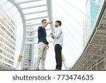 two business men stand talking... | Shutterstock . vector #773474635