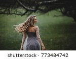 the beautiful lady walking near ... | Shutterstock . vector #773484742