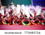 assorted candy bags in a lady... | Shutterstock . vector #773485726