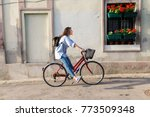young woman riding a bicycle... | Shutterstock . vector #773509348