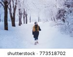 winter girl blowing snow.... | Shutterstock . vector #773518702