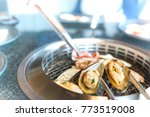 mussels grills on the stove. | Shutterstock . vector #773519008