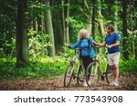 retired couple walking with... | Shutterstock . vector #773543908
