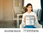 young woman hold calendar on...   Shutterstock . vector #773555656