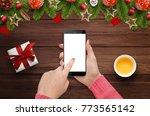 female hand holding smartphone... | Shutterstock . vector #773565142