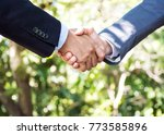 two businessman handshake... | Shutterstock . vector #773585896