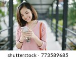 woman walking and using a smart ... | Shutterstock . vector #773589685