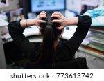 serious woman back grab her... | Shutterstock . vector #773613742