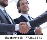 closeup.handshake of business... | Shutterstock . vector #773618572