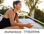 portrait of a happy fitness... | Shutterstock . vector #773635546