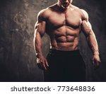 man showing his muscular body.   Shutterstock . vector #773648836