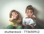 a boy and a girl show hands.... | Shutterstock . vector #773650912