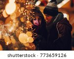 happy couple in warm clothes... | Shutterstock . vector #773659126