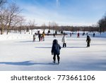 warmly dressed people skating... | Shutterstock . vector #773661106