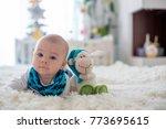 little cute baby boy  playing... | Shutterstock . vector #773695615