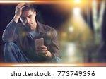 single sad man checking... | Shutterstock . vector #773749396