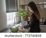 woman washing the dishes in... | Shutterstock . vector #773760838