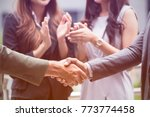 business people shaking hands... | Shutterstock . vector #773774458