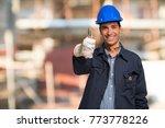 smiling worker in a... | Shutterstock . vector #773778226