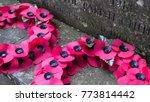 Poppy Wreaths Lie Beside A War...