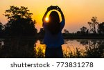 Silhouette Of A Woman Holding ...