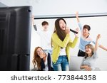 young woman holding microphone... | Shutterstock . vector #773844358