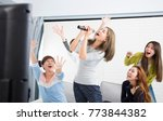 young woman holding microphone... | Shutterstock . vector #773844382