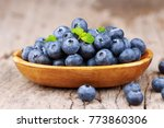 blueberries in a bowl on a... | Shutterstock . vector #773860306