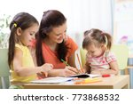 teacher or mom working with... | Shutterstock . vector #773868532