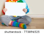 the child shows his child's...   Shutterstock . vector #773896525