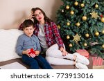 family sitting by the christmas ... | Shutterstock . vector #773913016