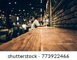 blur of wood bar table in night ...   Shutterstock . vector #773922466