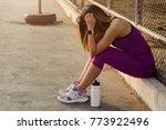 tired woman runner taking a... | Shutterstock . vector #773922496