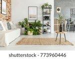 wooden stool with black vase on ... | Shutterstock . vector #773960446