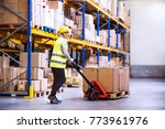 woman warehouse worker with...   Shutterstock . vector #773961976